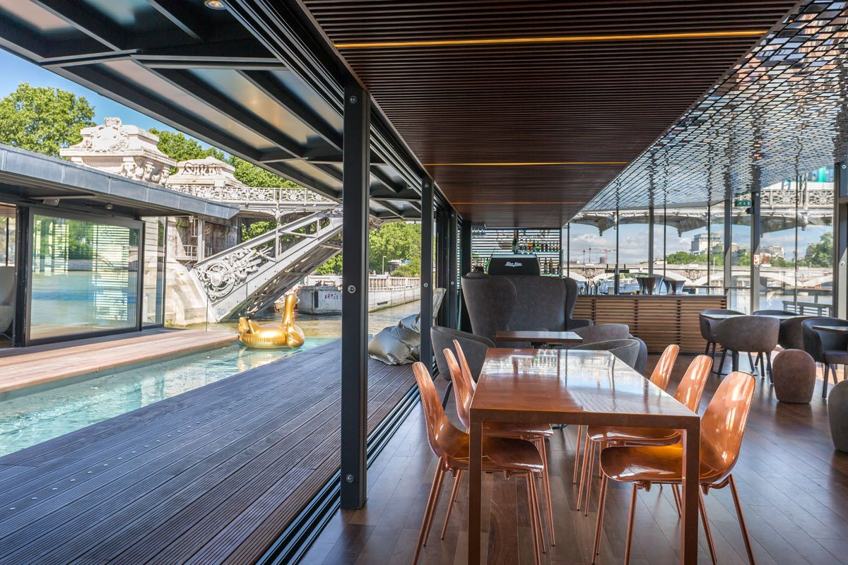 the-poolside-bar-area-is-unique-in-that-it-is-completely-open-air-and-has-the-feeling-of-a-roof-deck-it-will-be-enclosed-with-glass-in-the-winter